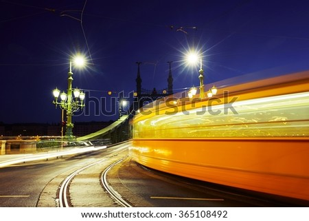 Tram on Liberty Bridge (Freedom Bridge) in Budapest, Hungary - stock photo