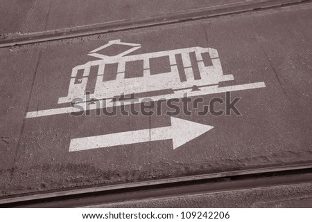 Tram Sign Painted on Road between Two Rails in Barcelona