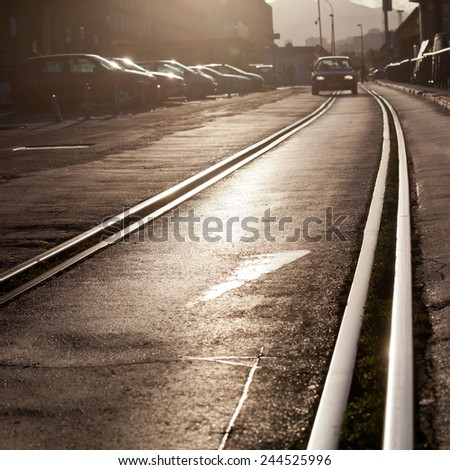 tram track in city with car - stock photo