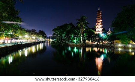 Tran Quoc pagoda at blue hour in Hanoi. This pagoda is located on a small island near the southeastern shore of West Lake. This is the oldest Buddhist temple in Hanoi, Vietnam. Panoramic style - stock photo
