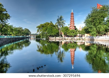 Tran Quoc pagoda in early morning in Hanoi, Vietnam. This pagoda is located on a small island near the southeastern shore of West Lake. This is the oldest Buddhist temple in Hanoi. - stock photo