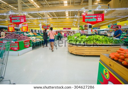 Trang, 25 june 2015: Rows with fruits and vegetables tables and boxes in Tesco Lotus supermarket in Trang, Trang province, Thailand.  Tesco Lotus is a largest hypermarket chain in Thailand.