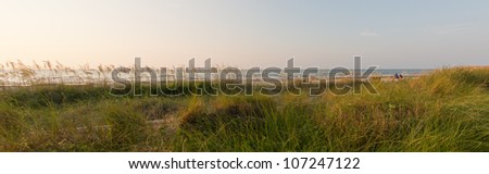 Tranquil beach scene at sunrise - stock photo