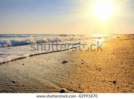 tranquil beach sunset on the deach of ocean - stock photo