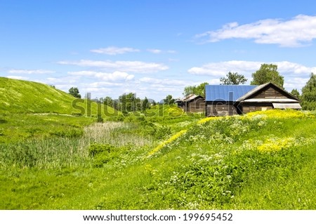 Tranquil colorful rural summer landscape with old wooden house. Horizontal image