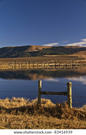 Tranquil dam in Natal Midlands South Africa during Winter - stock photo