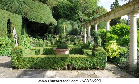 Tranquil Formal Garden Scene with Verdant Topiary Parterre - stock photo