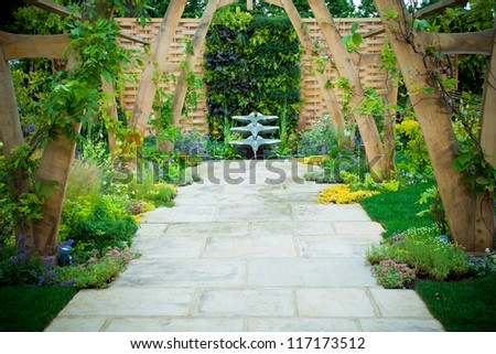 Tranquil garden with a fontain - stock photo
