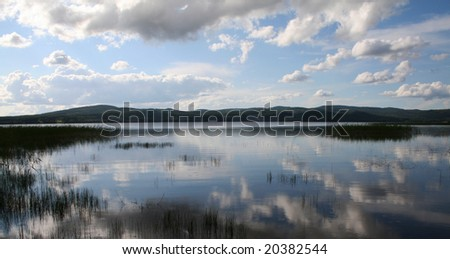 Tranquil lake - stock photo