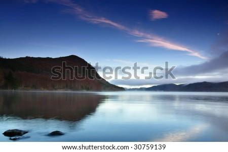 tranquil lake sunrise - stock photo