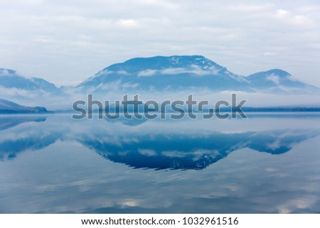 Tranquil morning landscape with mountain lake