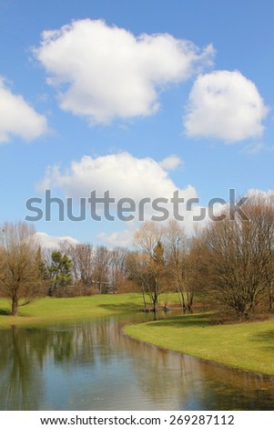 tranquil park scenery and blue sky with clouds - stock photo