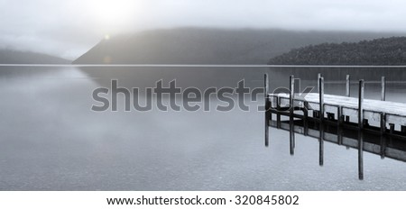 Tranquil peaceful lake with jetty New Zealand Concept - stock photo