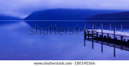 Tranquil Peaceful Lake With Pier, New Zealand - stock photo