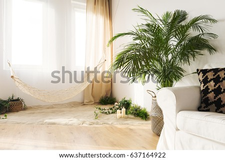 Tranquil Sand Living Room With Hammock, Couch, Widnow And Plant