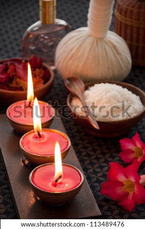 Tranquil scene of candles and spa accessories. - stock photo
