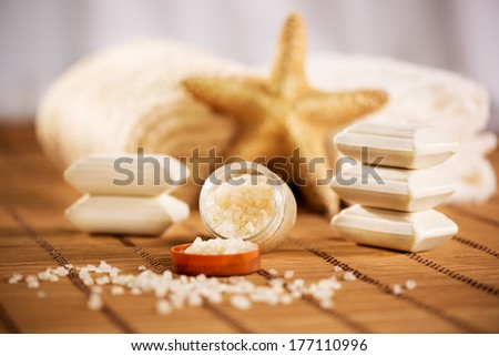 Tranquil scene with Towel, bath salt, soap, and sea-star. - stock photo