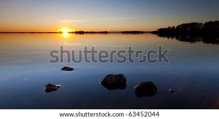 Tranquil sunset at the lake - stock photo