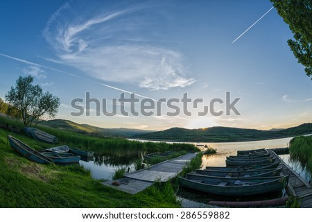 tranquil sunset near a remote lake - stock photo