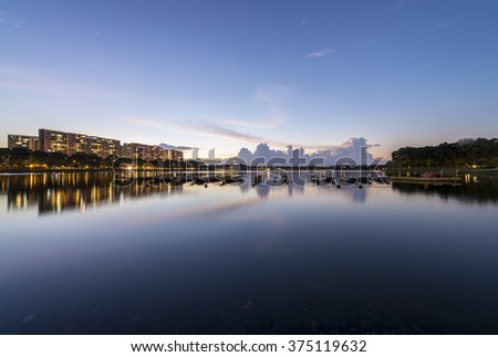 Tranquil water at reservoir during evening sunset - stock photo