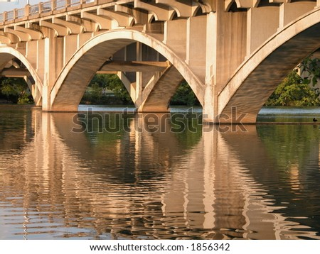 Tranquility and peace from the everyday city stress is felt sitting underneath a small bridge connecting south and north Austin, Texas on town lake. - stock photo