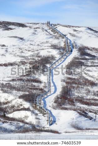 Trans-Alaska Oil Pipeline in the Alaska Range in Spring - stock photo