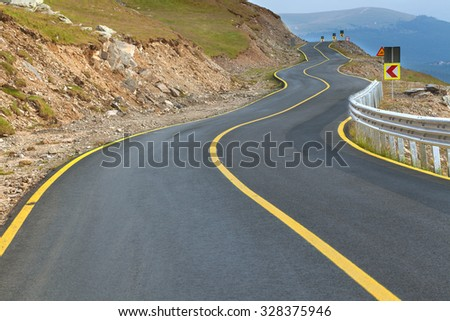 Transalpina zig zag road at day, highest and most dangerous asphalt road in Romania. - stock photo