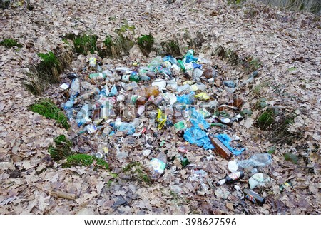 Transcarpathia, Ukraine - March 19, 2016: Plastic and glass bottles thrown into the trash in the woods