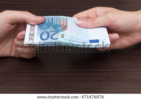 Transfer of cash money, euro currency, dark background