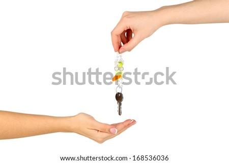Transfer of house keys isolated on white - stock photo