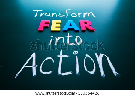 Transform fear into action concept, colorful words on blackboard - stock photo