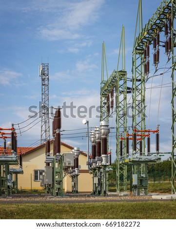 Transformation (transformer) electricity station - technology houses, high voltage lines, insulators. Vertical image.