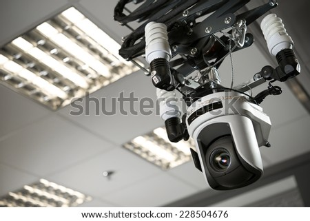 Translates the professional digital camcorder to TV - stock photo