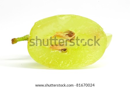 Translucent slice of green grape fruit, macro isolated on white - stock photo