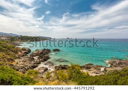 Translucent turquoise sea, rocky coastline and beach near to Ile Rousse in the Balagne region of Corsica