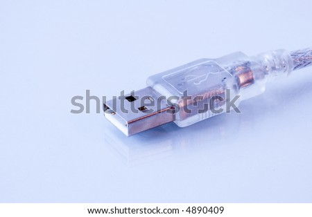 translucent USB connector reflected on glossy background. - stock photo