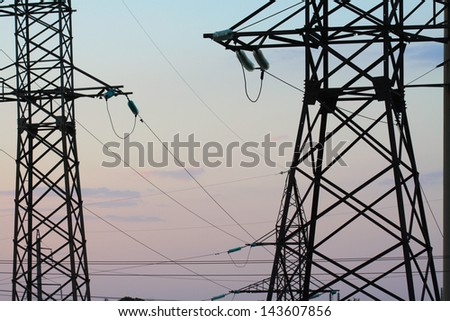 transmission line against the evening sky