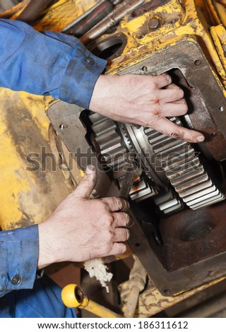 Transmission repair. Process of work by a close up. - stock photo