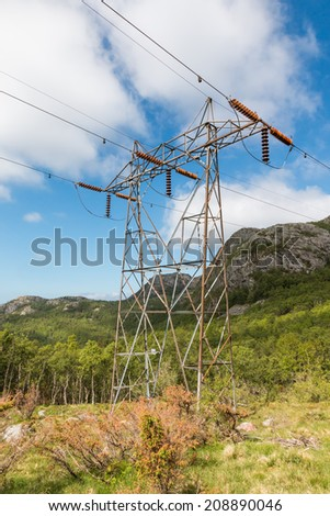Transmission tower leading up a rocky hill in the Rogaland mountains, Norway - stock photo