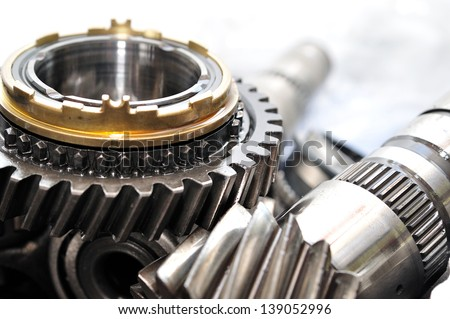 Transmission wheels and axle from car gearbox. - stock photo