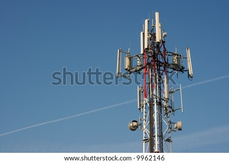 Transmitter tower against clear blue sky - stock photo
