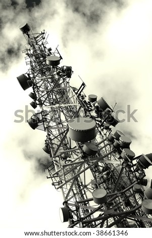 Transmitter tower against dramatic sky - stock photo