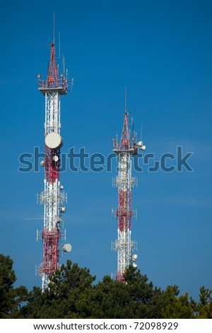 Transmitter towers against clear blue sky