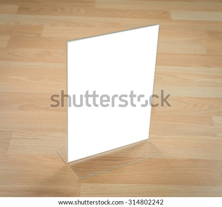 Transparent acrylic table stand menu holder - stock photo