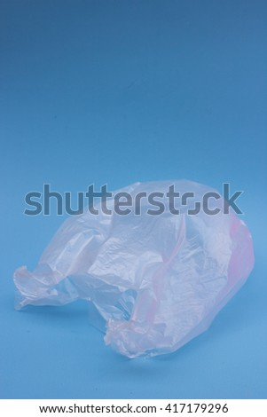 transparent bag on a blue background - stock photo
