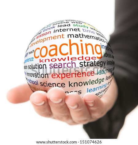Transparent ball with inscription coaching in a hand - stock photo