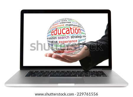 Transparent ball with inscription education in a hand from display of laptop - stock photo