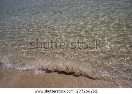 transparent beach waves in Corfu for background - summer - stock photo