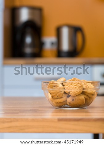Transparent bowl with cookies close up shoot on the kitchen table - stock photo