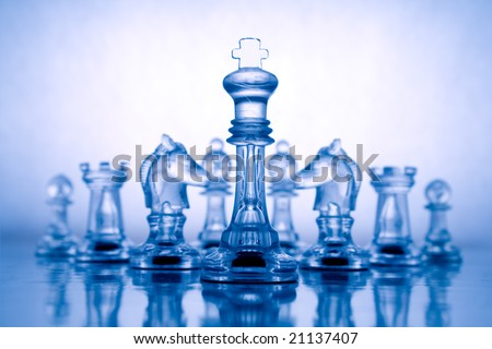 Transparent chess on a blue background - stock photo